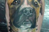tattoo of dog on leg