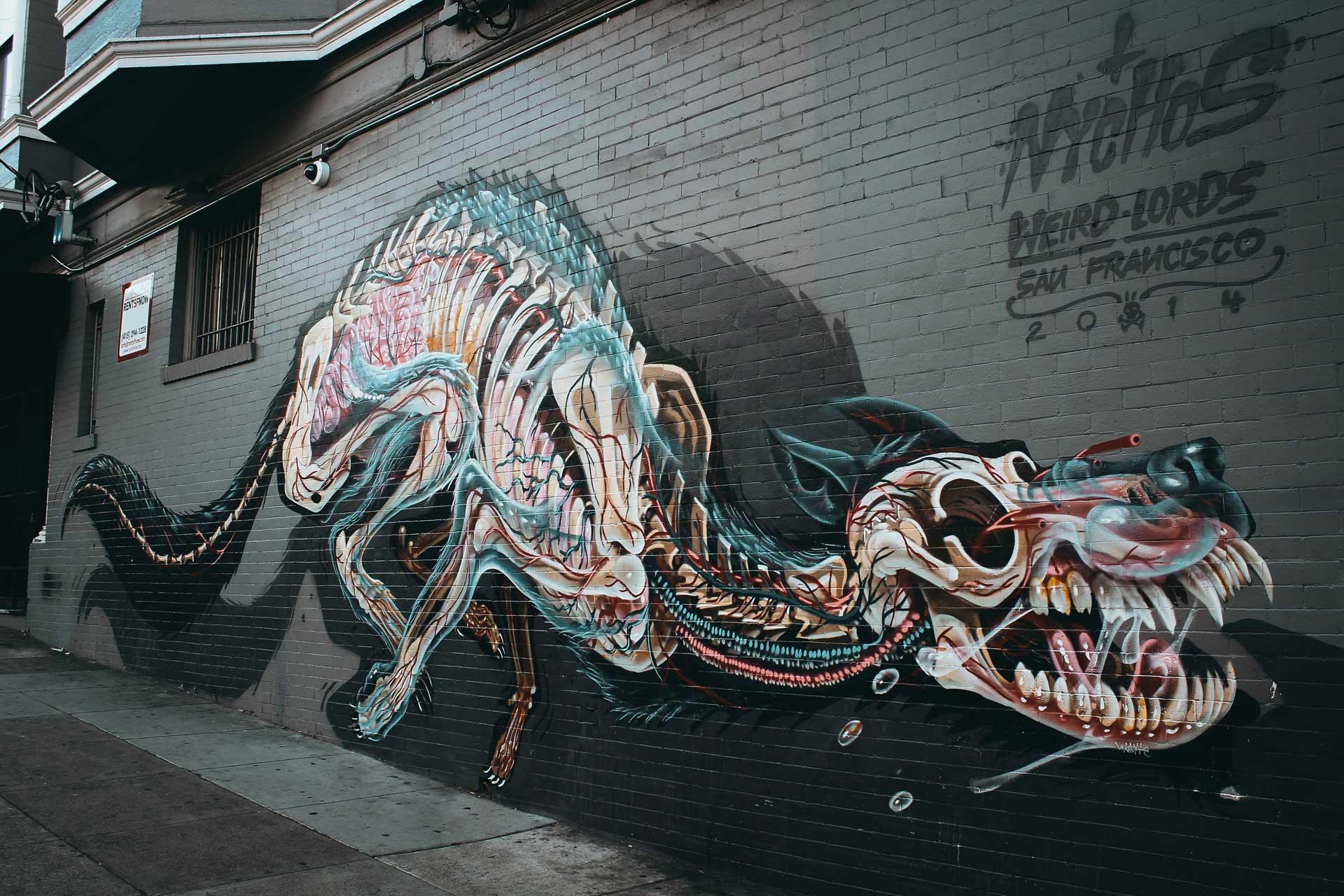 mural of dog skeleton on black wall